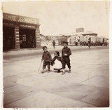 Three children walking past a lifeboat station, Whitby, North Yorkshire, c 1905.