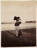 A woman carrying fishing equipment, Whitby, North Yorkshire, c 1905.