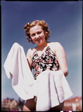 Woman in swimsuit with towel, c 1945.