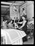 Factory workers making flags, 1945.