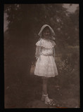 Girl wearing a bonnet and lace dress, 1908.