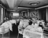 View of dining room of Cunard liner, 9 April 1954.