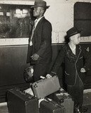 Young Jamaican boy looks after his family's luggage, September 1954 .