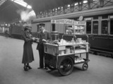 Passenger at a refreshment trolley, Paddington Station, 1937.