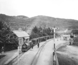 Passenger train at Tan-Y Bwlch Station, c 1909.
