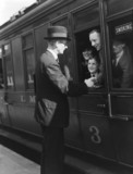 Passengers at a station, 1937.