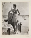 Woman at a marina, c 1930.