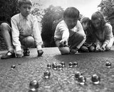 Children playing marbles, 1970.