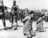 Two Chinese traitors seen before their execution, 2 July 1938.