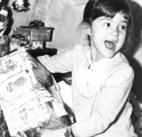 Katie Fisher opening a Christmas present, Cheshire, December 1984.