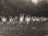 Men exercising with rifles, early 20th century.
