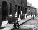 Slum property, London, c 1930s. 'Coaltman S