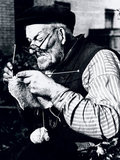 Elderly man knitting as part of the war effort during WWII, 31 October 1939.