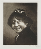 Smiling child wearing a hat.;