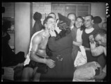 Eddie Phillips receives a kiss, 1937.