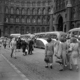 Newly arrived passengers walking to tour coaches outside St Pancras, 1950.