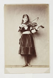 Xie Kitchin playing a violin, 1876.
