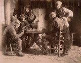 Men playing cards, c 1900.
