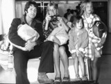 Paul McCartney with wife and children, London Airport, September 1974.