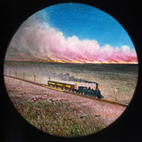 Prairie on fire with train, hand-coloured magic lantern slide, 19th century.