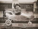 Boy sitting in a toy aeroplane, Selfridges, London, 18 December, 1931.