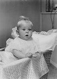 """Baby in a cot, 1956"""