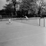 """Two men 'playing tennis', 1955"""