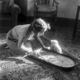"""Young girl playing bagatelle, c 1930s."""