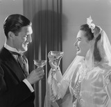 """Bride and groom drinking a toast, c 1949."""