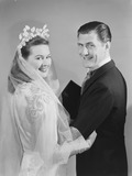 """Smiling bride and groom, c 1949."""