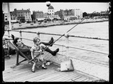 Child fishing on the pier, 29 July 1937.