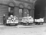 """Trolleys at Oldham Road goods depot, Manchester, c 1924."""