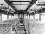 """Interior of a first class train carriage, 1924. """