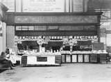 """WH Smith bookstall, Manchester Victoria Station, c 1926."""