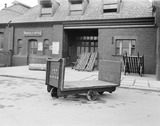 """Platform trolley, parcel office, Barrow Station, Cumbria, 11 February 1930.  """