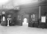 """Ticket office at Barrow Station, Cumbria, 11 February 1930."""