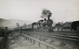 LMS 4-4-0 locomotive No.516 on a Manchester to Sheffield Express near Chinley North Junction, 2nd July 1932. S.T. Cowan M_34, Album 3.