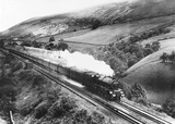 The London, Midland & Scottish Railway 5P5F class 4-6-0 locomotive number 5200 with a passenger train at Dillicar water troughs, Cumbria, about 1945.