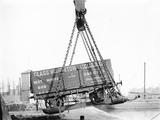 Crane hoisting a railway wagon at Goole docks, about 1919.