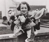 Female shop assistant holding toys, 5 November 1932.