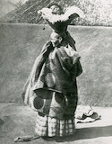 Native woman with a baby on her head