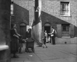 Postman delivering mail in Wapping - 1935