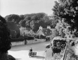 Lewes - postman riding through Telscombe  - 1937