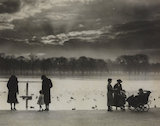 Walkers enjoying the sunset across the Serpentine in Hyde Park, 1938