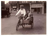 Children riding a bicycle and sidecar, c 1930