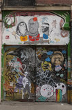 Graffiti collage on doorway in East London