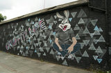 Graffiti in East London of man with a rabbit head with the words Graffiti Life