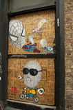 Graffiti in East London of spiderman and humorous character