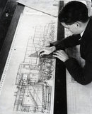 Draughtsman Brian Pearson, an employee in the Drawing Office, working on drawing for War Department. 1945.
