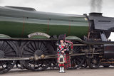 Piper in front of theFlying Scotsman locomotive after its inaugural run at North Yard, National Railway Museum, February 25th 2016.
